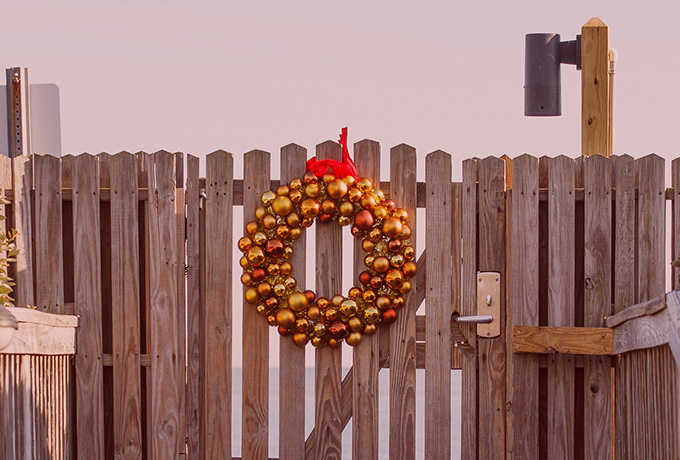 Entertaining guests with a Christmas wreath hanging on a gate