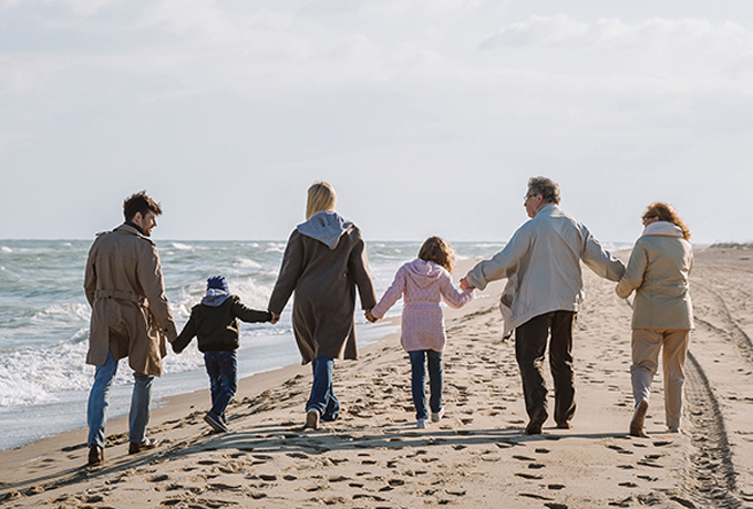 family communication - family walking along a beach