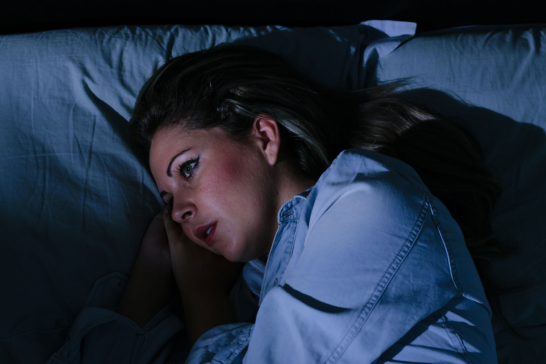 Women sleeping worrying about mental health issues