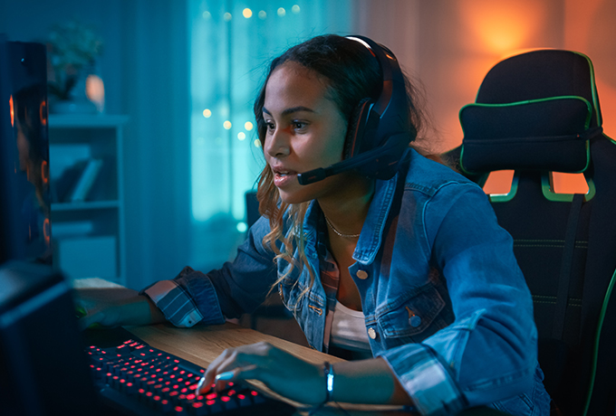 A woman connecting with others playing and online video game
