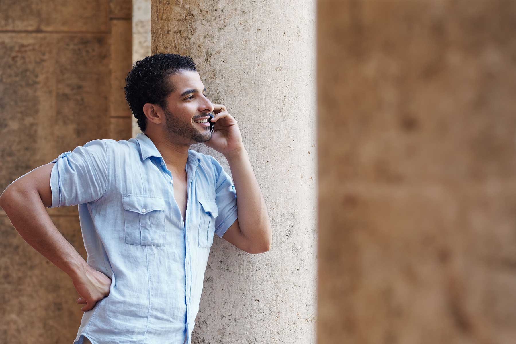 Man on phone talking with friends